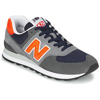 Scarpe Uomo Sneakers basse New Balance 574 Grigio / Arancio