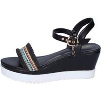 Scarpe Donna Sandali Enrico Coveri sandali pelle sintetica tessuto nero