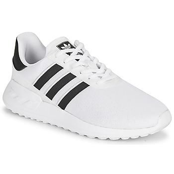 Scarpe Unisex bambino Sneakers basse adidas Originals LA TRAINER LITE J Bianco / Nero