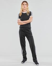 Abbigliamento Donna Pantaloni da tuta adidas Originals FIREBIRD TP PB Nero