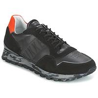 Scarpe Uomo Sneakers basse Bikkembergs FEND-ER 946 Nero / Arancio